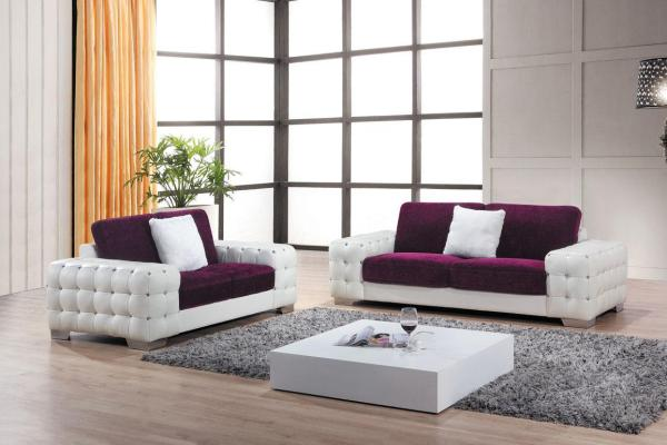 White and purple modern sofa with square low profile coffee table in beautiful room